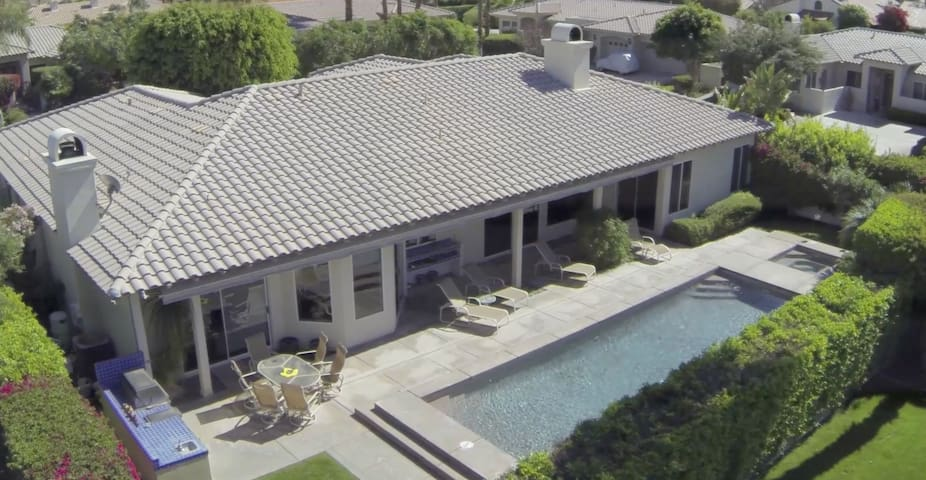 Overhead shot of this south-facing/sun drenched dynamo. Note the blue tiled outdoor kitchen to left and infinity pool to right. Partial view of the hot tub on the far right of photo.  Majority of public rooms + Master Suite face the pool and incredible mountain views.