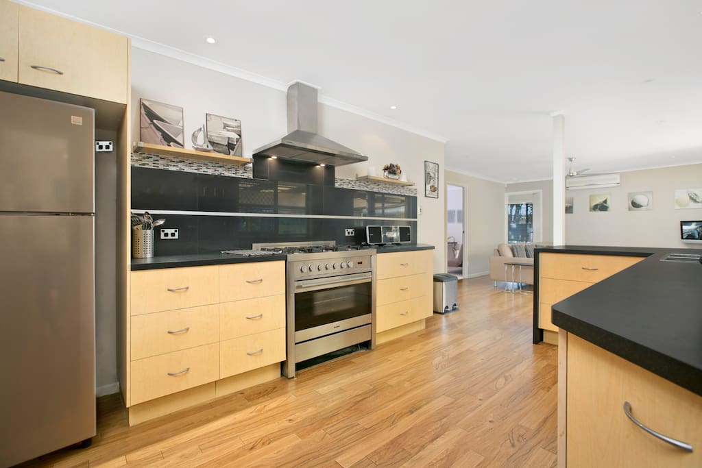 Contemporary Kitchen with name brand stainless steel appliances and a comprehensive inventory