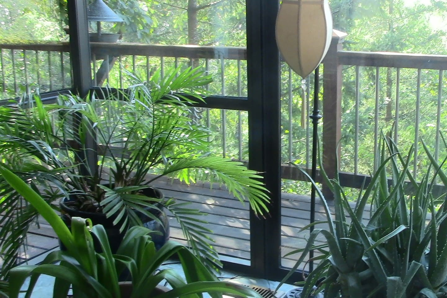Condo has a private deck overlooking a natural, wooded back garden