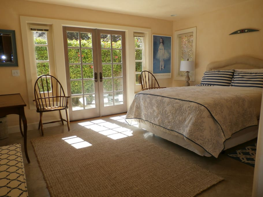 Lower Queen bedroom #1 with French doors to private, sunny patio.