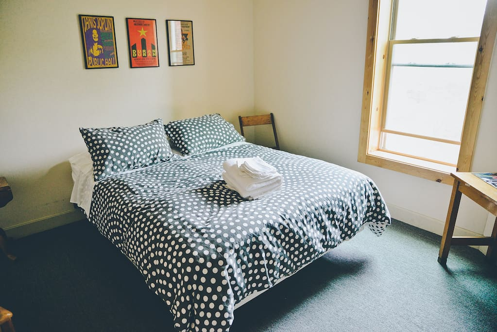 Bright, fresh room with queen size bed.
