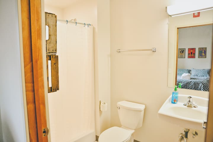 Full, bright, and clean bathroom
