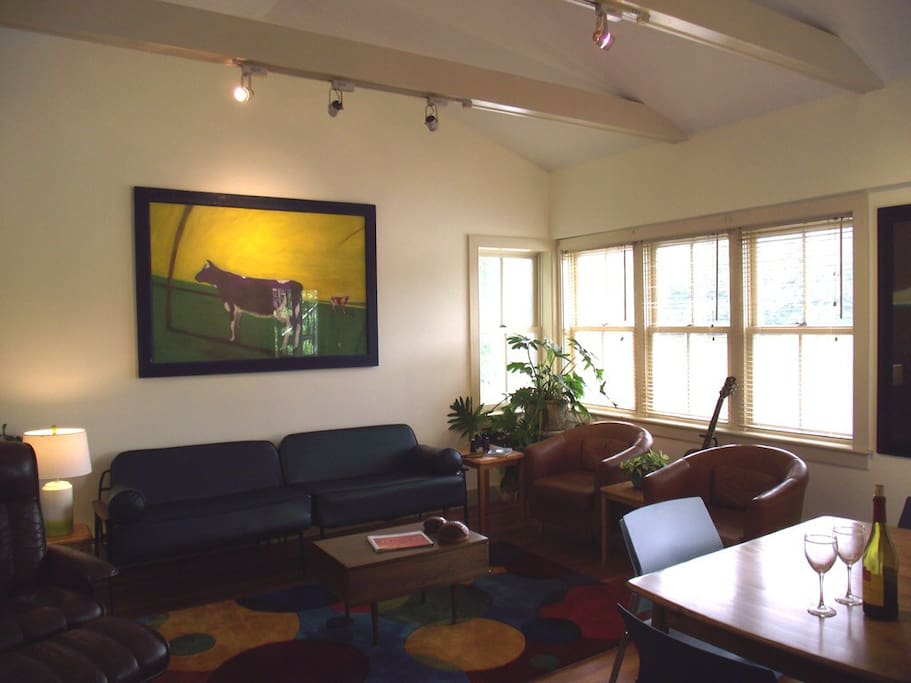 Comfortable, spacious living and dining room overlooking Rising Pond.
