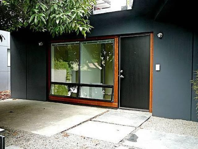 Your private studio tucked into the eastern slope of Magnolia. Award-winning mid-century building.