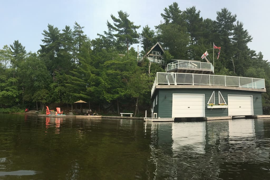 View of the cottage, bunkie and boathouse from the water.