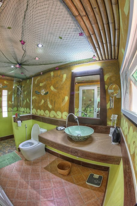 Hand painted and decorated bathroom complete with full amenities.