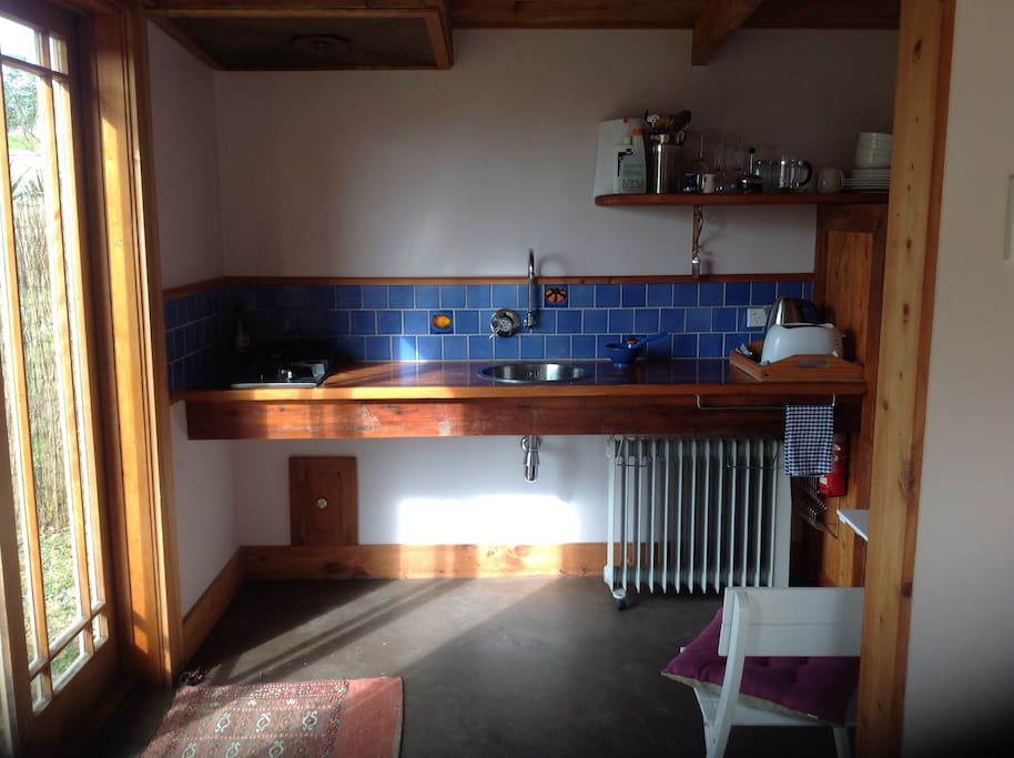 Fully equiped kitchen with gas hob, and fridge for you to do your own cooking.