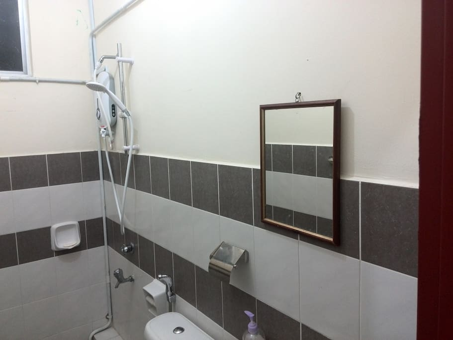 Toilet and bathroom with water heater