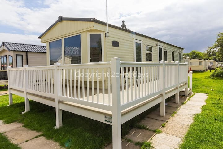 8 berth caravan for hire at Broadland Sands with decking Suffolk ref 20213BS