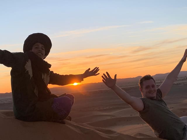 My son rachid with aour guests enjoying the beautiful sunset in the desert