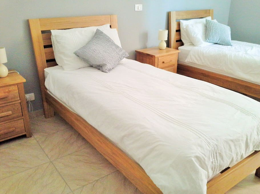 Single beds can be pushed together to create king size bed with middle strip so no hard edges