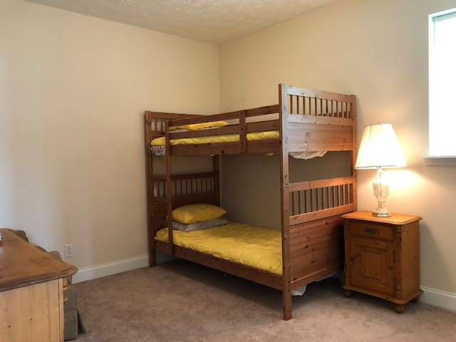 Kids will Love this Bunk Room with Oversized Chair to the Right