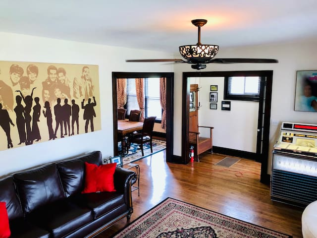 First floor living room with sleeper sofa and fully restored jukebox!  Large windows look out over West Grand Blvd.