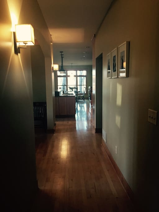 Hallway from main entry leads to kitchen, dining, library & screen porch