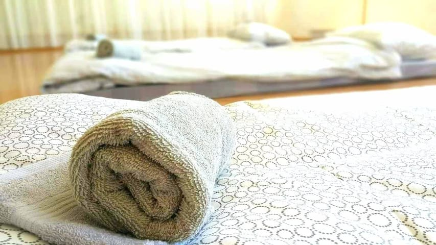 TEJ Hostel floor mattress beds in shared bedroom.