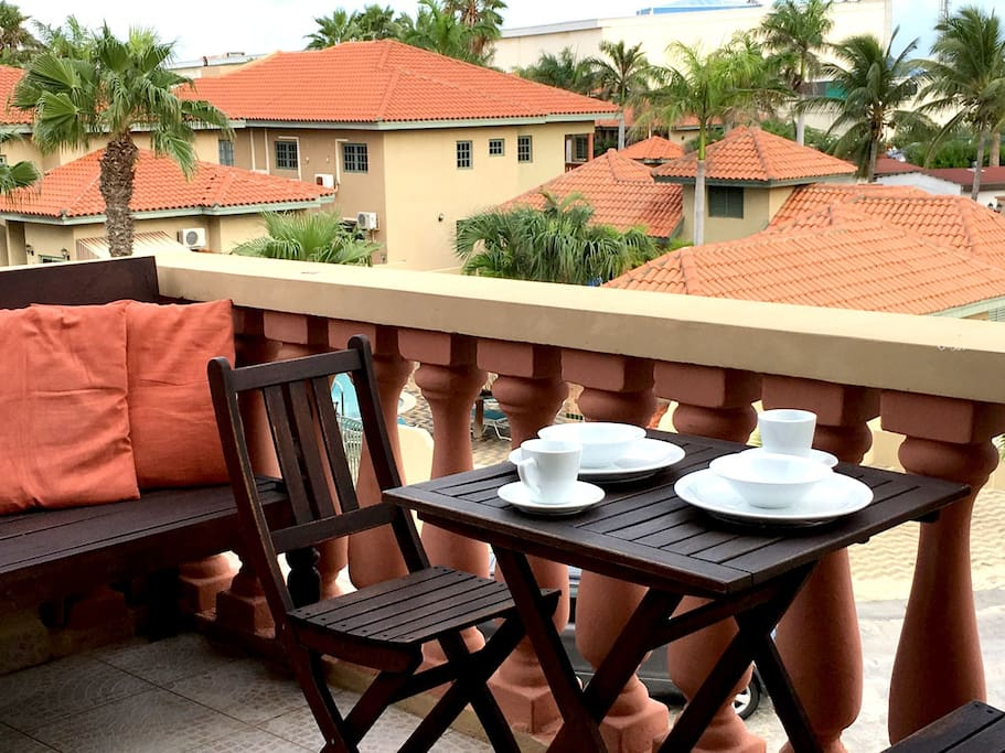 Have breakfast or enjoy the weather on the private balcony