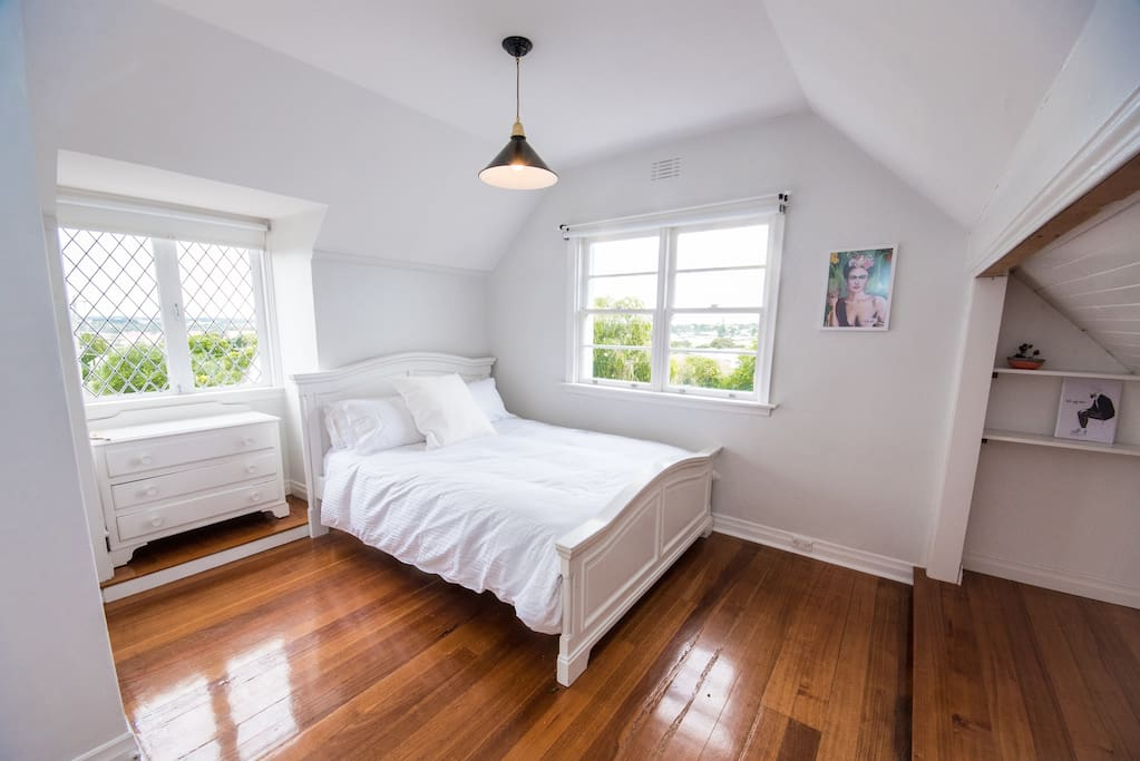 Upstairs bedroom #3 - French windows that open and look out over Warrnambool city.