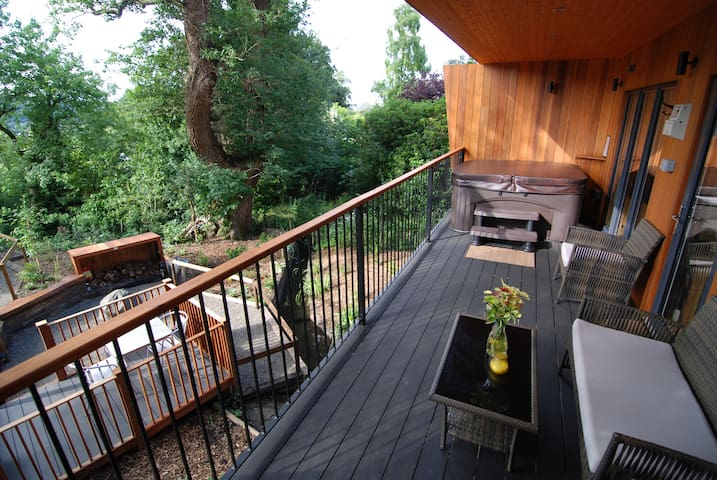 Covered composite deck area provides outdoor space even if it's raining.