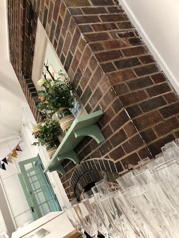 Brick fireplace in the main dining room - rustic theme wedding venue