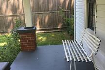 Relax on the wide front porch's bench, or...