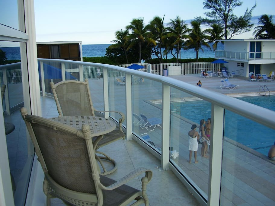 Balcony w table and lounge chairs