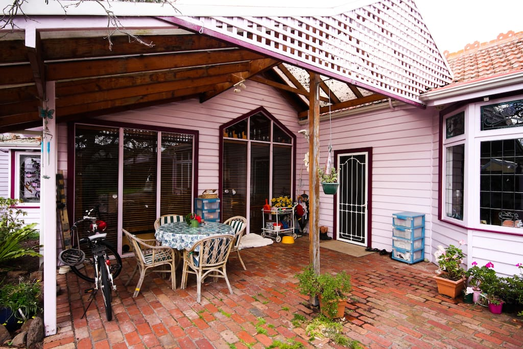 Under cover back verandah patio where smoking is allowed - may also use bike
