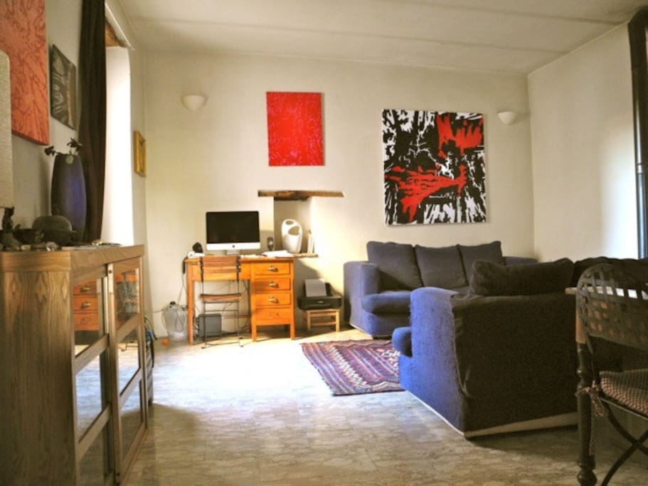 Our comfortable living room adorned with Robertos' art work