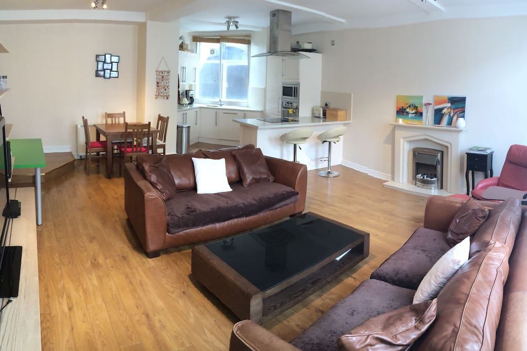 Spacious living room with open plan kitchen