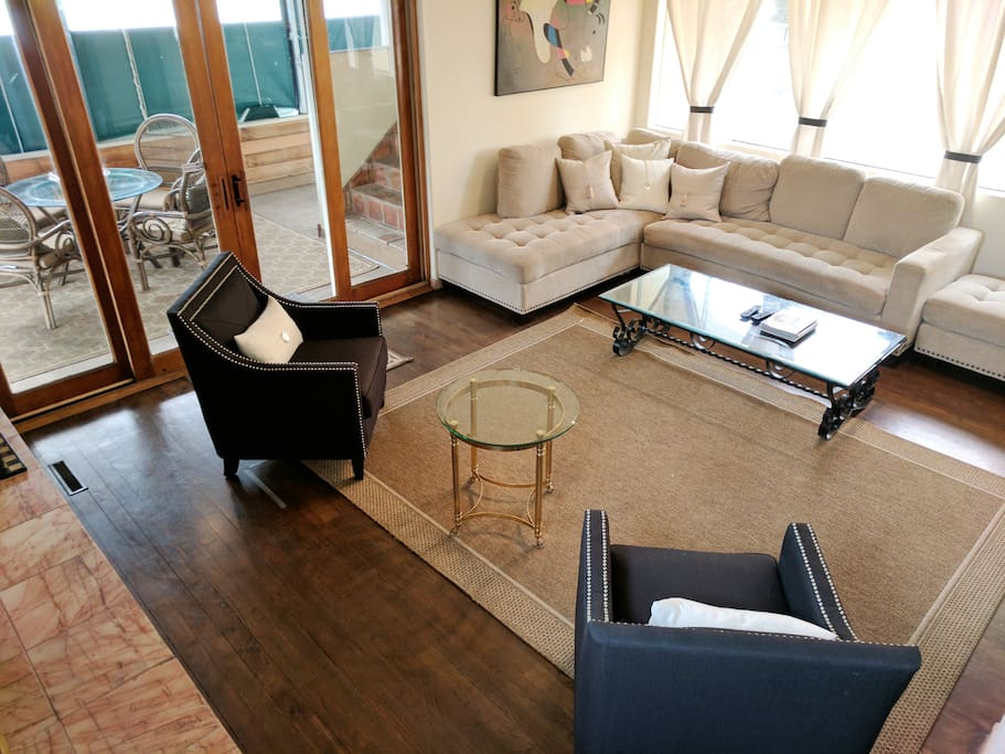 Large living room with outside patio.