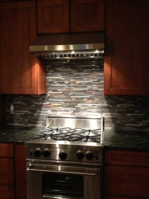 This is the gas range in the kitchen, I laid all the tile myself!