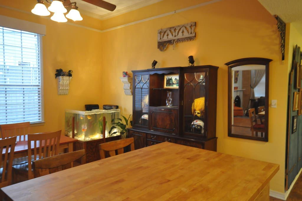 Custom aquarium and mahogany display cabinet with New Orleans themed artwork.