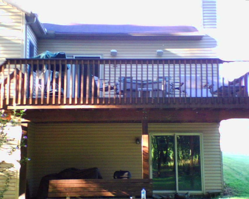 Rear View Showing Ground Level Walk-In Storage Space & Living Level Balcony