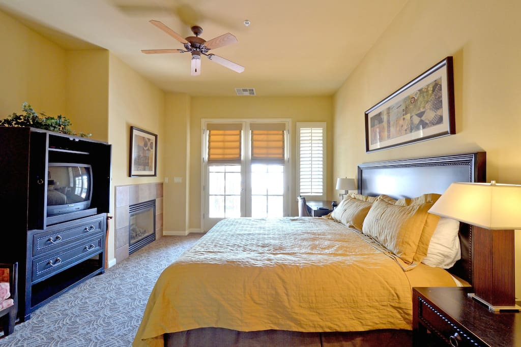 King Size Bed with Flat screen T.V. and desk.  Opens on to semi-private patio.