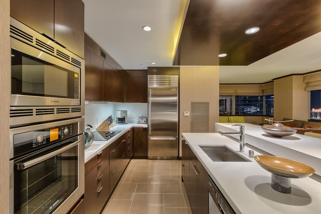 Fully furnished kitchen with stainless appliances, full size fridge, oven, stovetop and microwave. Toaster, plates, utensils and cookware too.