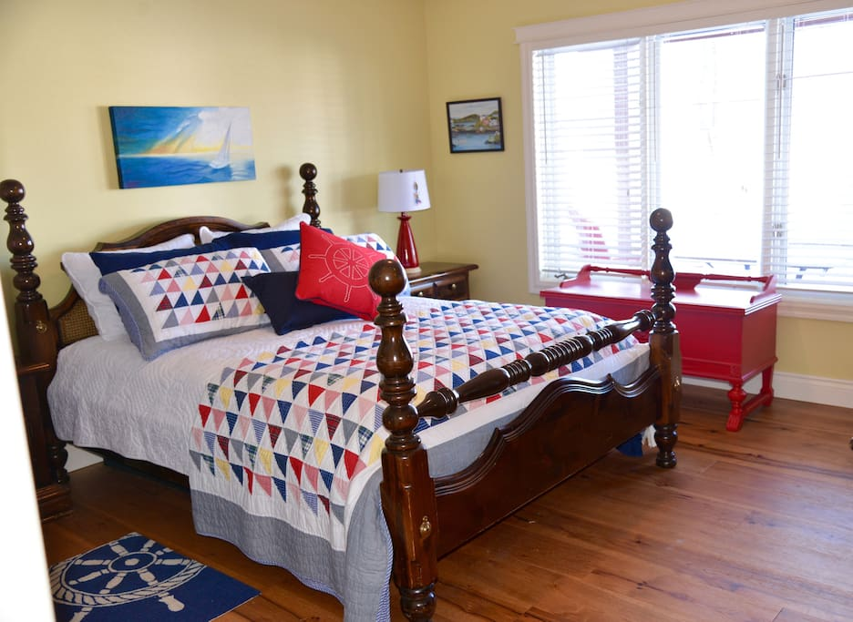 Our spacious nautical guest bedroom with a comfy Queen size bed and a private view of Vernon Narrows