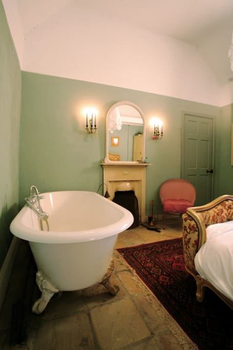 Roll top bath for 2 in the bedroom Photo:- Susie Rea