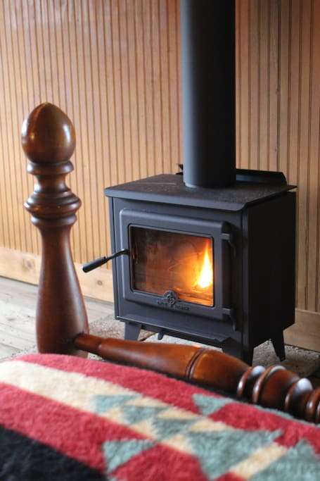 SMELL THE WOODSMOKE!!  New wood stove is in, placed between the two twin beds.  Fall asleep to the flicker of the fire!