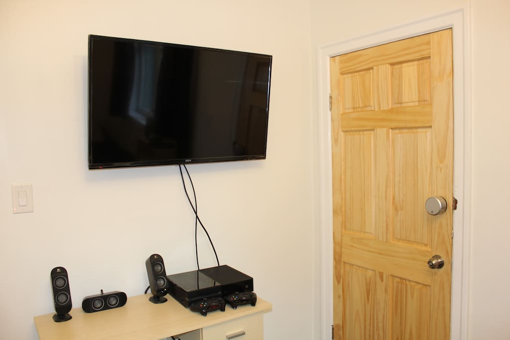 Large flat-screen TV to watch from bed
