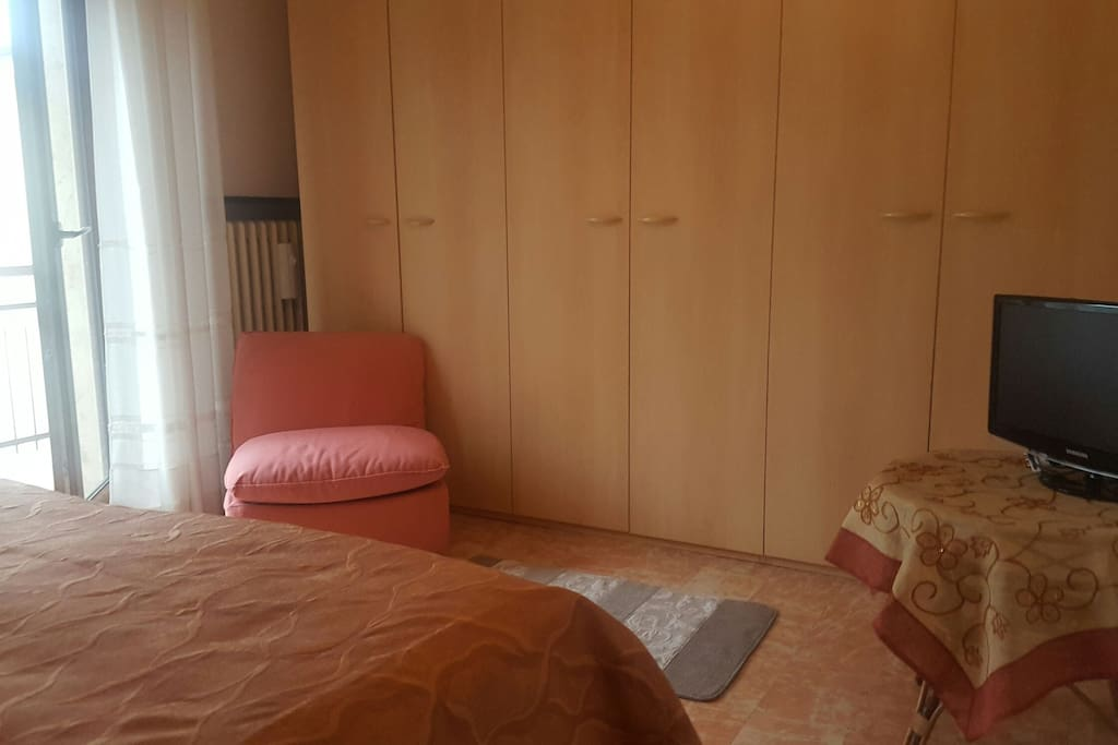 Double Bedroom with balcony and tv