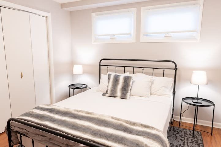 Bedroom #2 is located downstairs and has a queen bed with a hybrid coil/memory foam Allswell mattress. There are windows providing natural light to give the room an open feeling. USB plugs are provided to charge your devices at night.