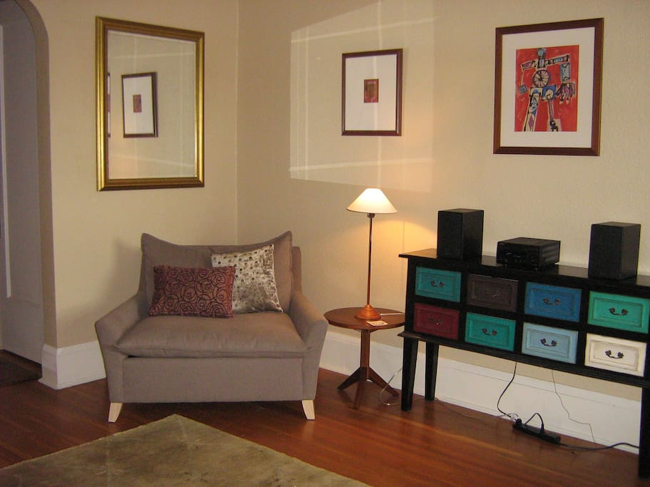 Living room south east.  Front hall way shown on far left side of picture
