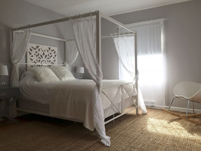 Spacious master bedroom with two walk in closets and dresser. Ample storage. Queen bed.