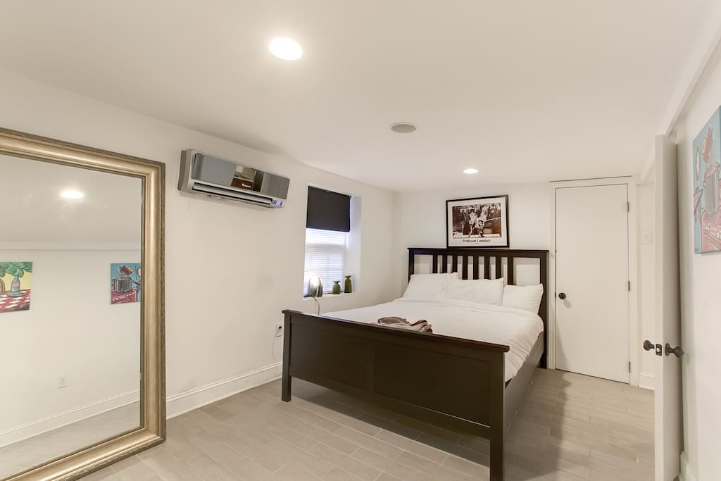 First bedroom with a queen bed