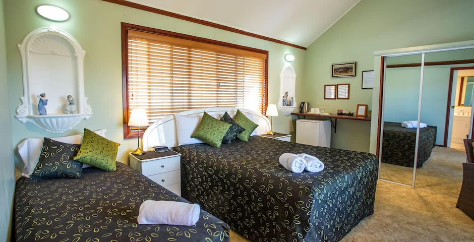 Deluxe Queen room with extra bed. This room opens directly on to the deck.
