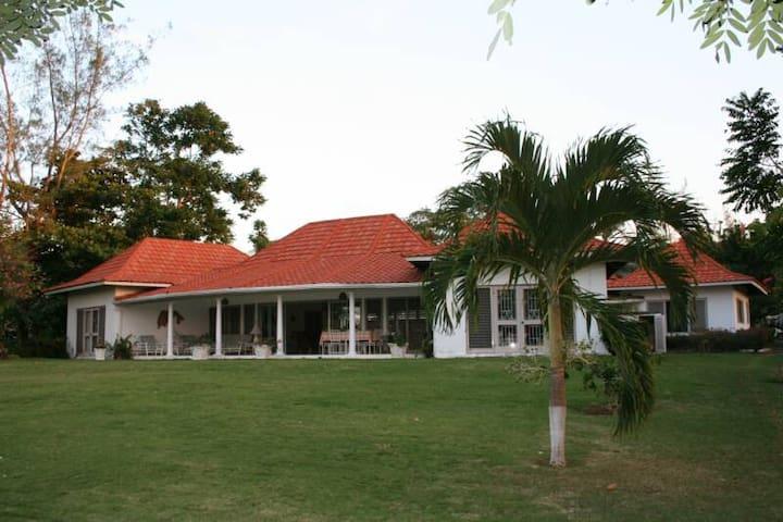 "Carousel Villa on the Golf Course, ""Sunrise Room""."