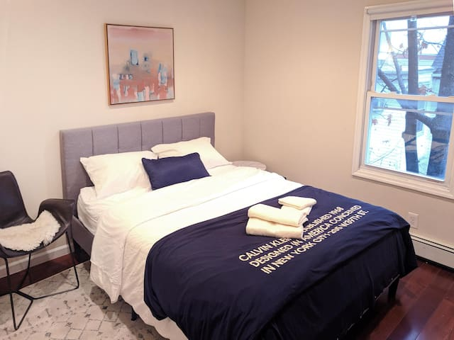 Queen size bed, hotel quality bed sheet, and a large closet. A reading table can be added upon request.