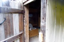 The Privy / Eco-Outhouse - simple compost style effeicient odorless but does require some compost effort! -though minor.