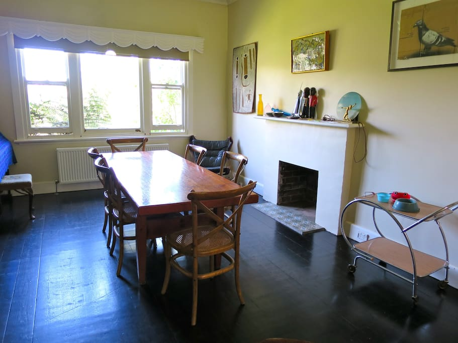 Front of house dining room, with open fire and city views