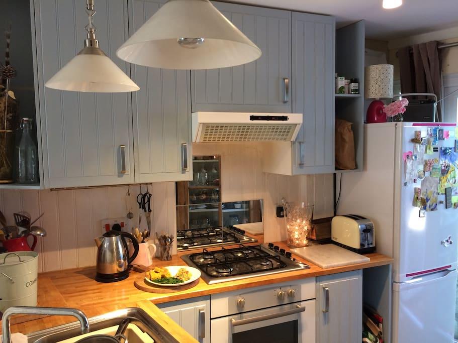 Open plan lounge kitchen includes dishwasher & fridge freezer