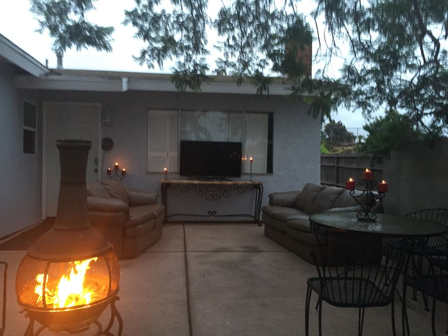 FRONT PATIO ENTERTAINING AREA UNDER SHADE TREE. WATCH TV & EATING DRINKING AREA